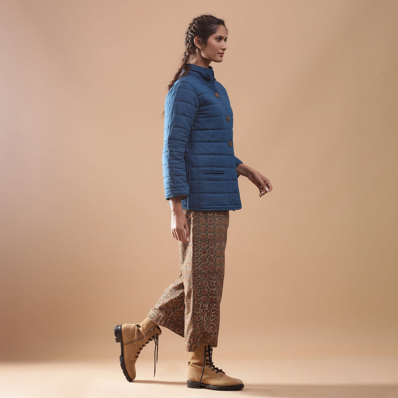 Right View of a Model wearing Reversible Detachable Hoodie Quilted Cotton Jacket