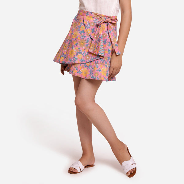 Left View of a Model wearing Reversible Flared Tie Up Mini Skirt