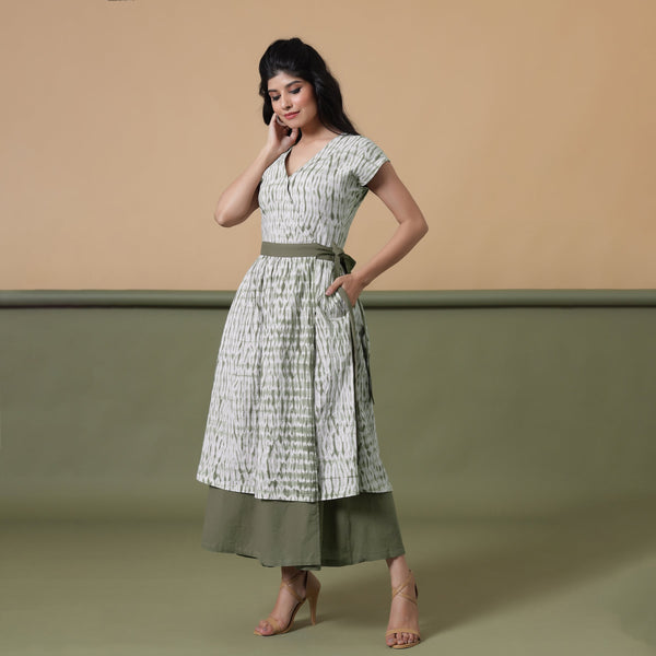 Front View of a Model wearing Reversible Shibori Green Wrap Dress
