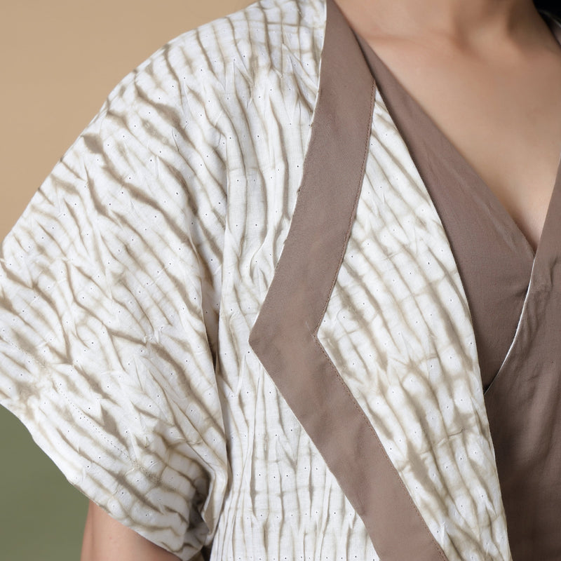 Front Detail of a Model wearing Taupe Shibori Front Open Overlay