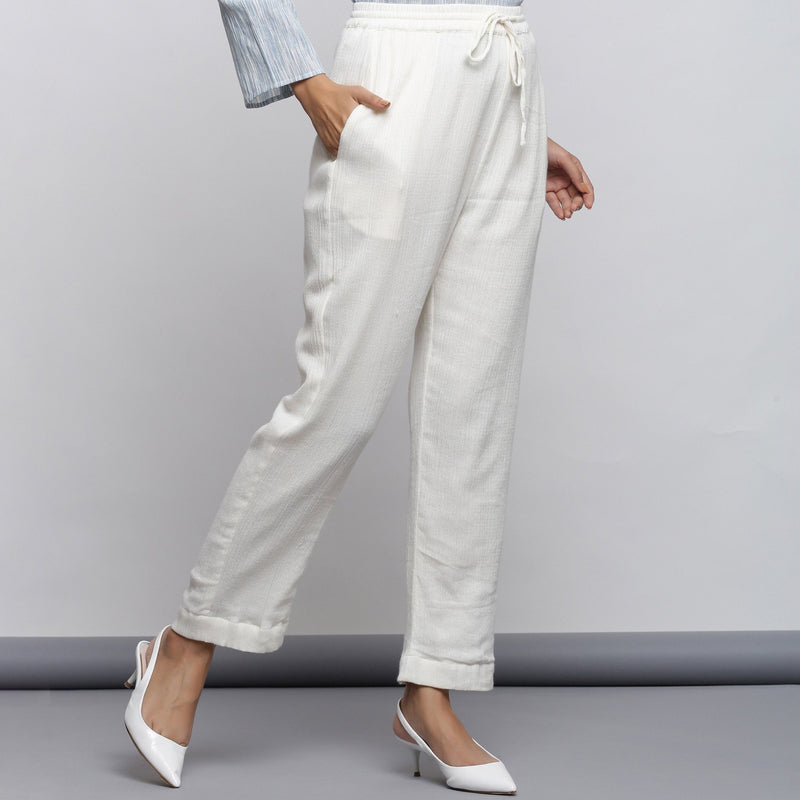 Right View of a Model wearing Off-White Crinkled Cotton Tapered Pant