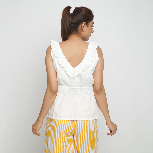 Back View of a Model wearing Ruffled Off-White Cotton Peplum Top
