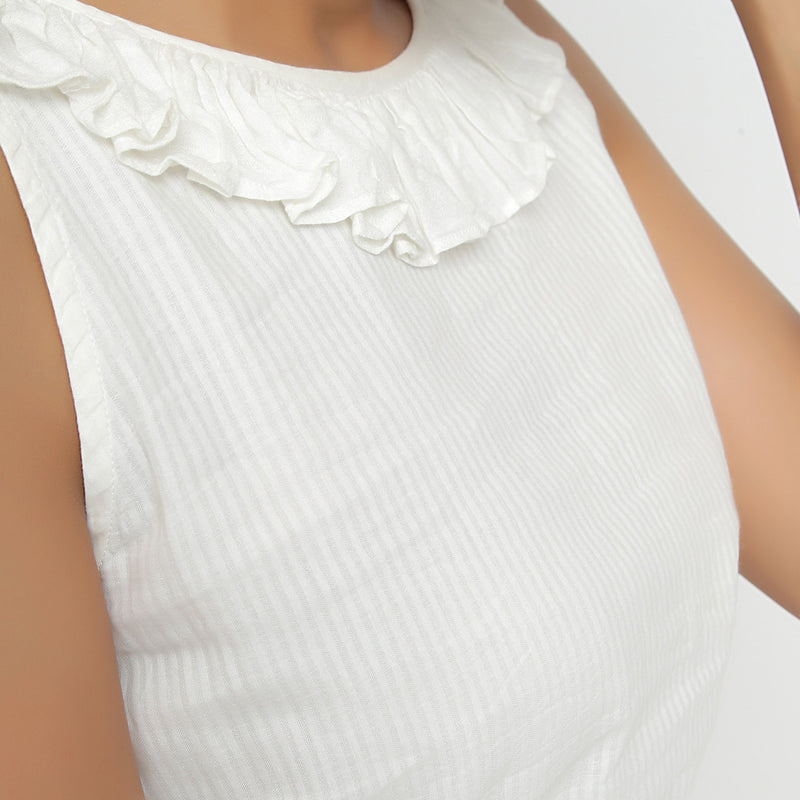 Front Detail of a Model wearing Ruffled Off-White Peplum Top