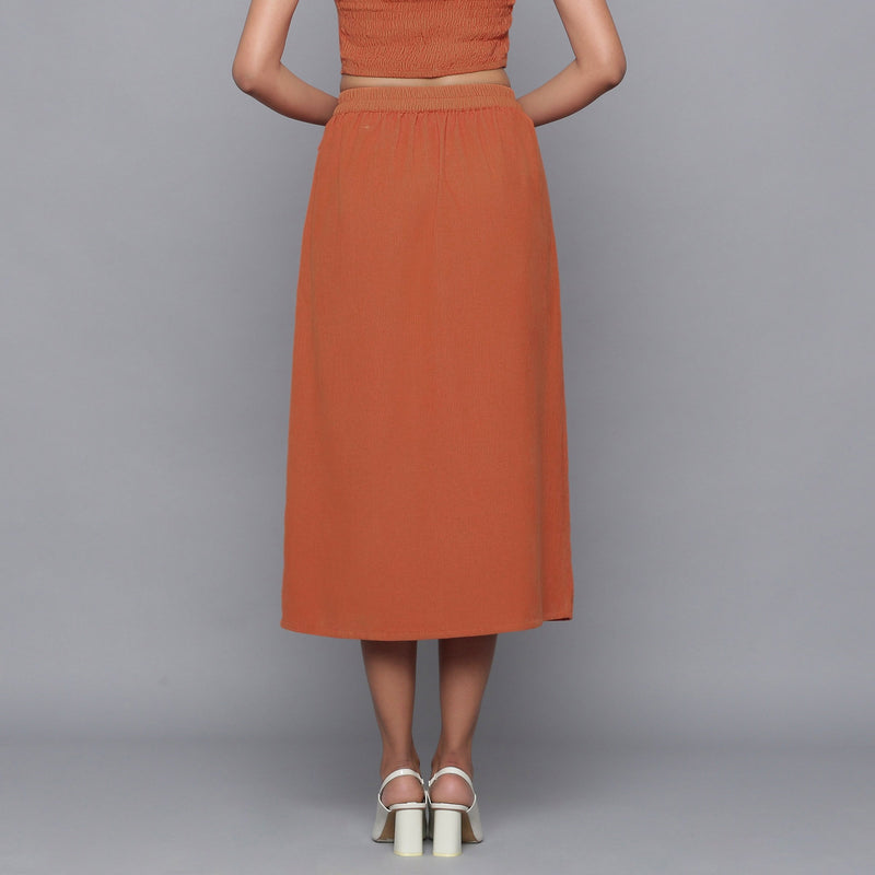 Back View of a Model wearing Sunset Rust Button-Down Midi Skirt