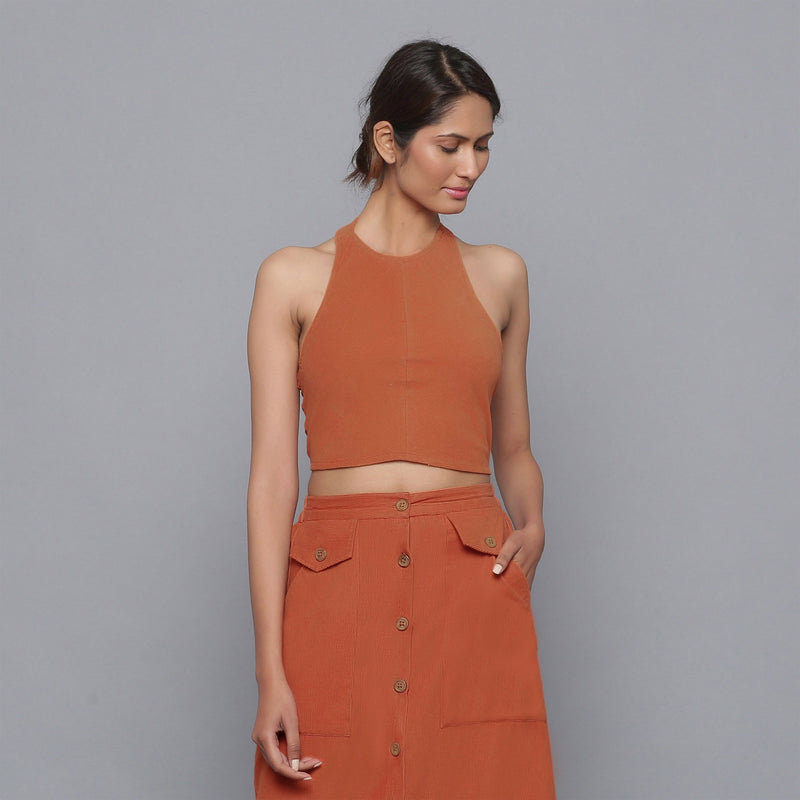 Front View of a Model wearing Sunset Rust Corduroy Halter Neck Top
