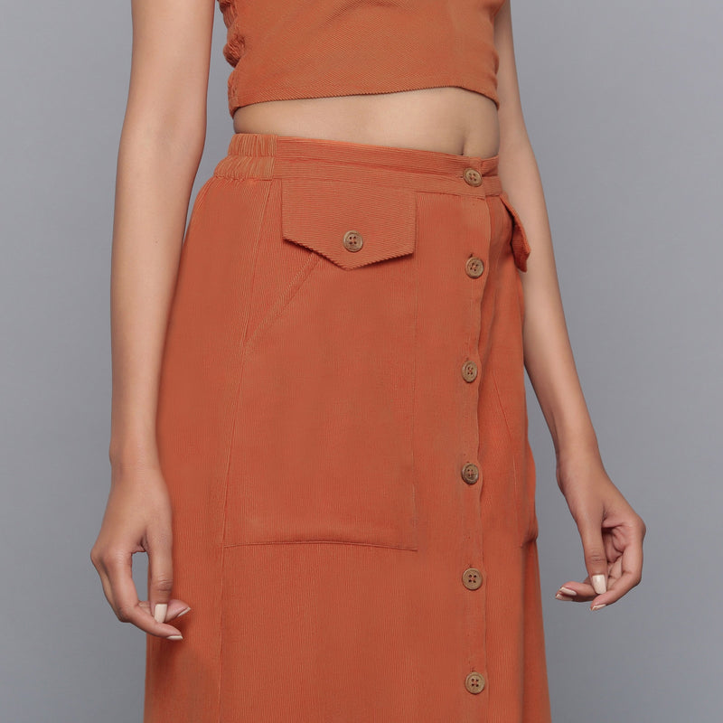Right View of a Model wearing Sunset Rust Button-Down Midi Skirt