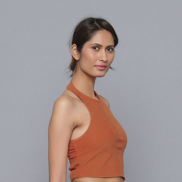 Right View of a Model wearing Sunset Rust Corduroy Halter Neck Top