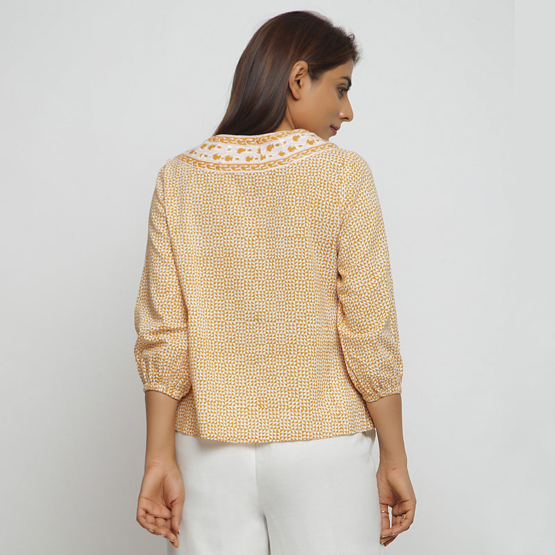 Back View of a Model wearing Mustard Hand Block Printed Straight Top