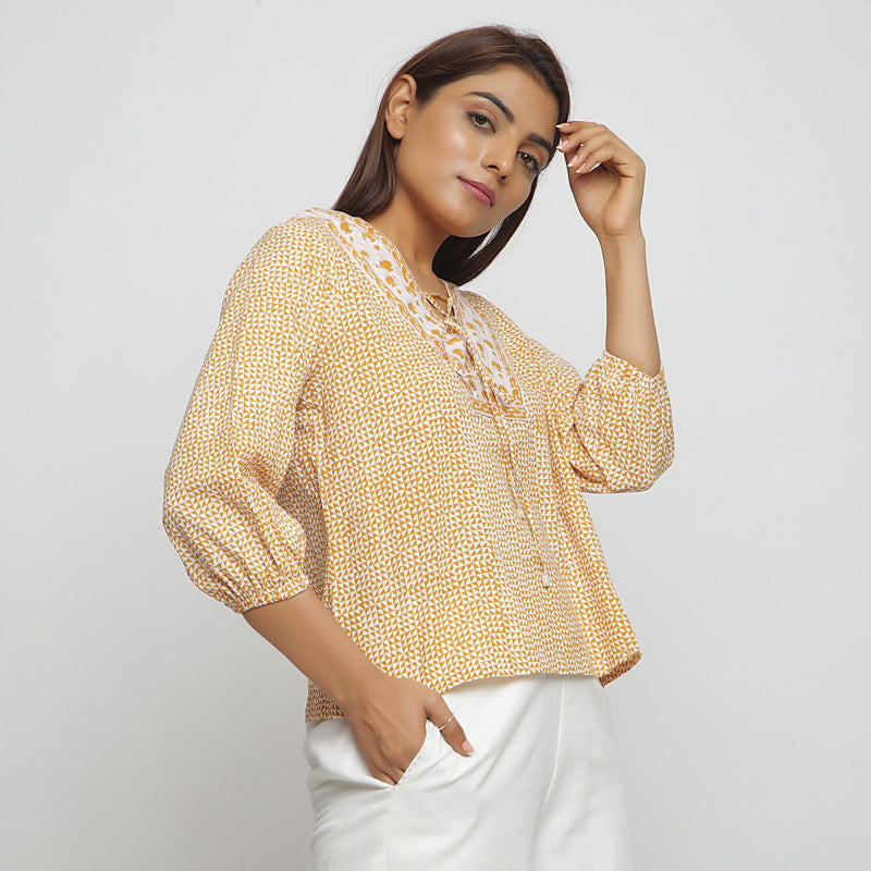Right View of a Model wearing Mustard Hand Block Printed Straight Top