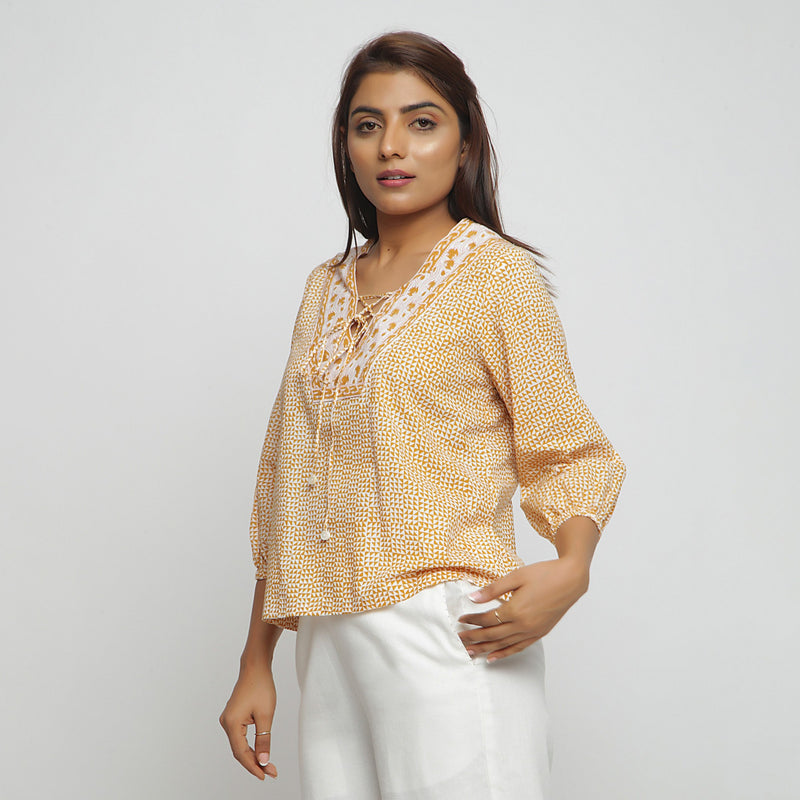 Left View of a Model wearing Mustard Hand Block Printed Straight Top