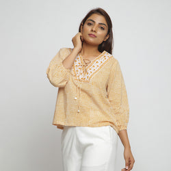 Front View of a Model wearing Mustard Hand Block Printed Straight Top