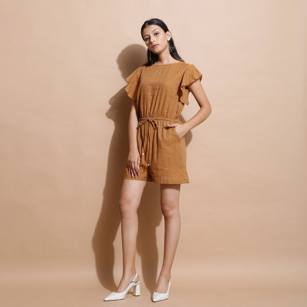 Front View of a Model wearing Rust Handspun Solid Cotton Playsuit