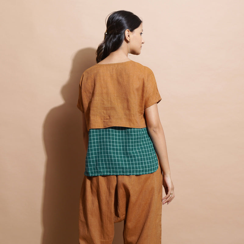 Back View of a Model wearing Rust Cotton Muslin Lined High Low Top