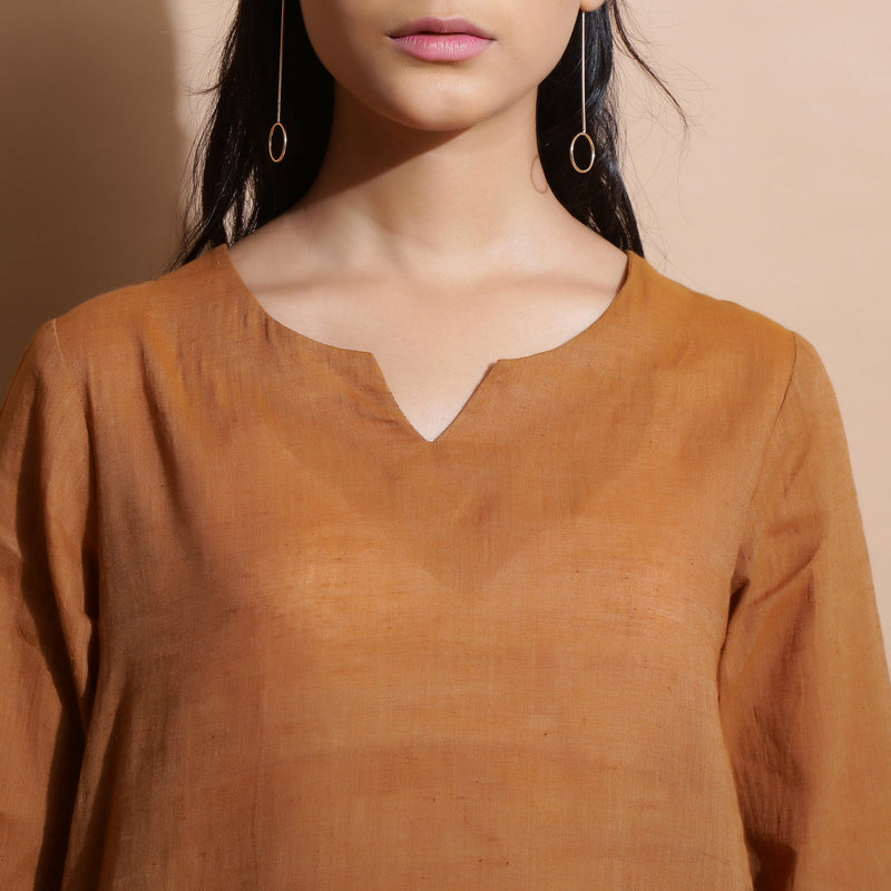 Front Detail of a Model wearing Rust Cotton Muslin Solid Handspun Top