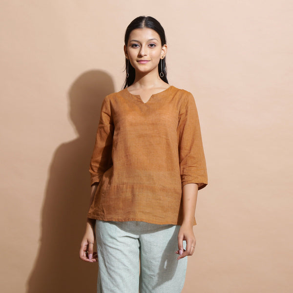 Front View of a Model wearing Rust Cotton Muslin Solid Handspun Top