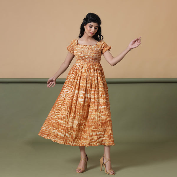 Front View of a Model wearing Rust Shibori Elasticated Gathered Dress