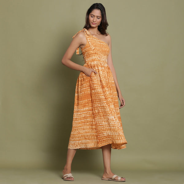 Right View of a Model wearing Rust Shibori One-Shoulder Midi Dress