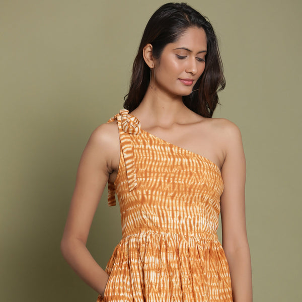 Front View of a Model wearing Rust Shibori One-Shoulder Midi Dress