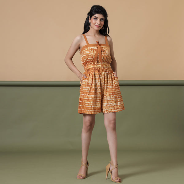 Front View of a Model wearing Rust Shibori Strappy Gathered Romper