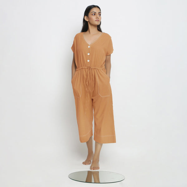 Front View of a Model wearing Rust Vegetable Dyed Button-Down Jumpsuit