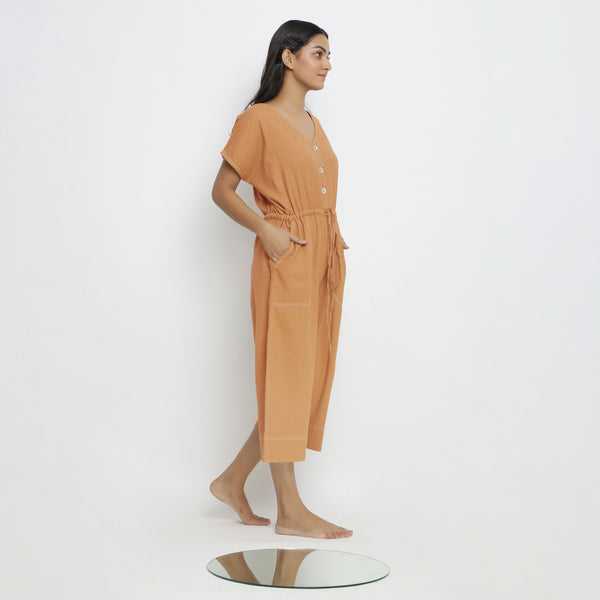 Right View of a Model wearing Rust Vegetable Dyed Button-Down Jumpsuit