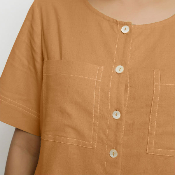 Front Detail of a Model wearing Rust Vegetable Dyed Romper