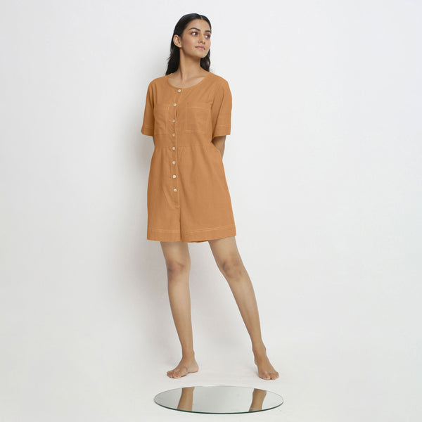 Front View of a Model wearing Rust Vegetable Dyed Romper