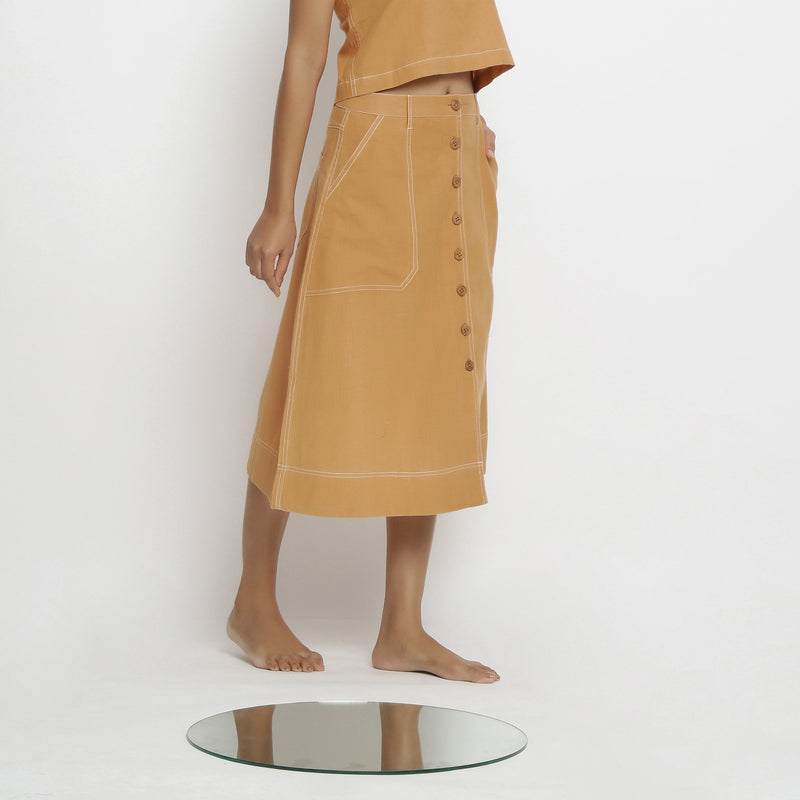 Right View of a Model wearing Rustic Vegetable Dyed Button-Down Skirt