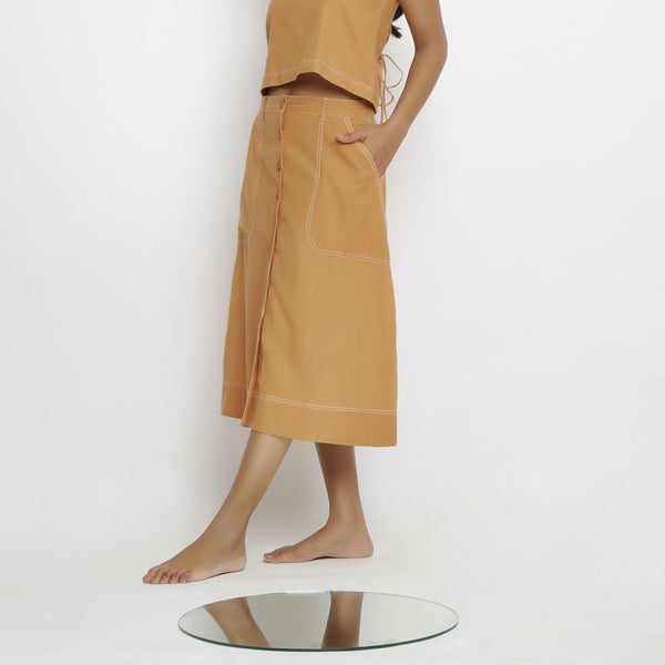Left View of a Model wearing Rustic Vegetable Dyed Button-Down Skirt