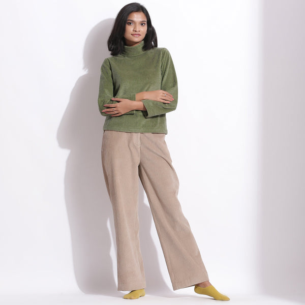 Front View of a Model wearing Sage Green Corduroy High Neck Top
