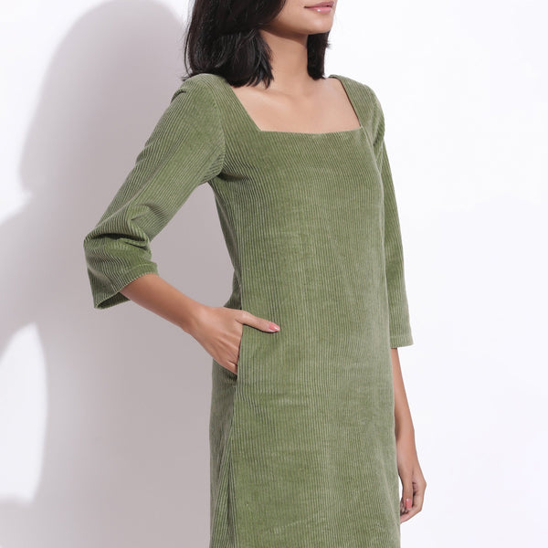 Front Detail of a Model wearing Sage Green Cotton Corduroy Square Neck Dress