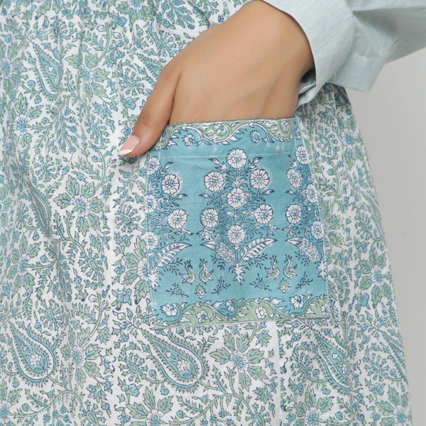 Left Detail of a Model wearing Sage Green Handblock Print Gathered Skirt