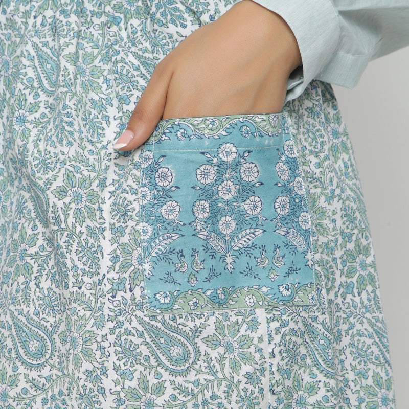 Left Detail of a Model wearing Sage Green Hand block Print Gathered Skirt