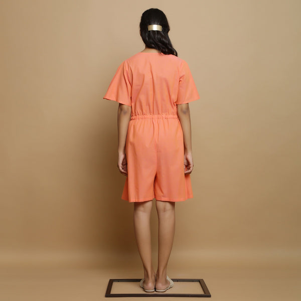 Back View of a Model wearing Salmon Pink Button-Down Godet Jumpsuit