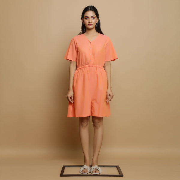 Front View of a Model wearing Salmon Pink Godet Button-Down Jumpsuit