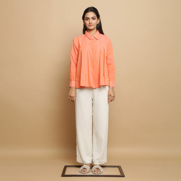 Front View of a Model wearing Salmon Pink Godet Top and Undyed Pant Set