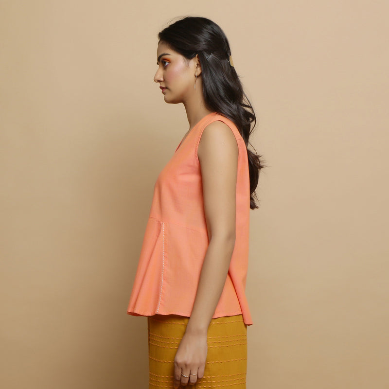 Left View of a Model wearing Salmon Pink Hand-Embroidered Flared Top