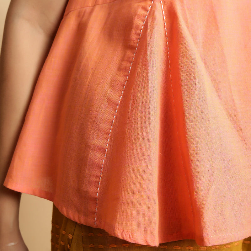 Close View of a Model wearing Salmon Pink Hand-Embroidered Flared Top