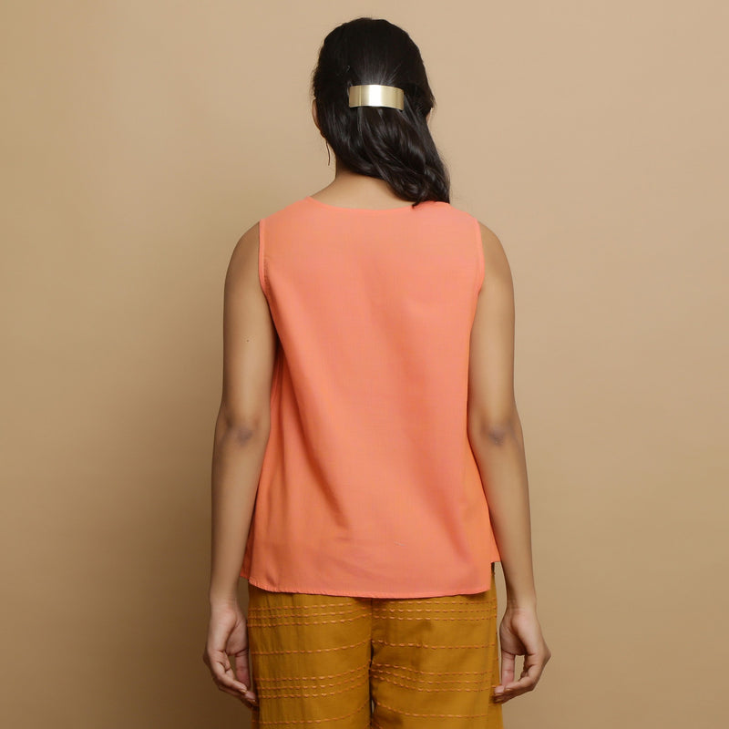 Back View of a Model wearing Salmon Pink Hand-Embroidered Flared Top