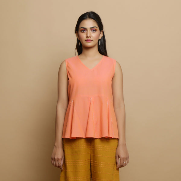 Front View of a Model wearing Salmon Pink Hand-Embroidered Godet Top