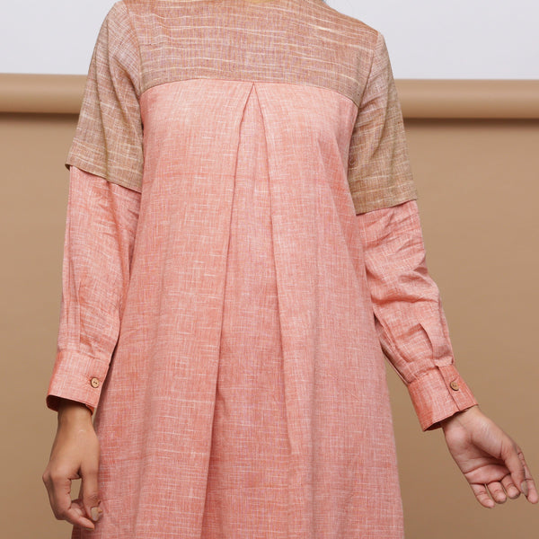 Front Detail of Model wearing Salmon Pink Handspun Pleated Dress