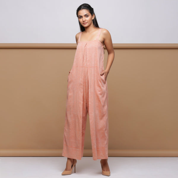 Front View of Model wearing Salmon Pink Handspun Pleated Jumpsuit
