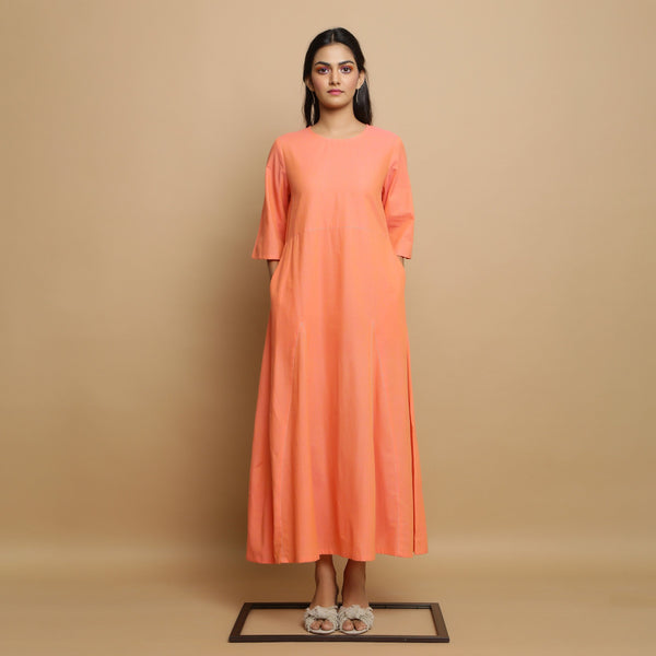 Front View of a Model wearing Salmon Pink Mangalgiri Cotton Godet Flared Dress