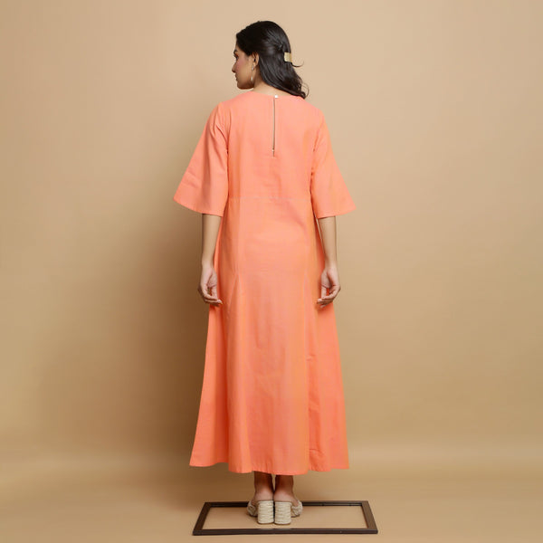 Back View of a Model wearing Salmon Pink Mangalgiri Cotton Godet Flared Dress