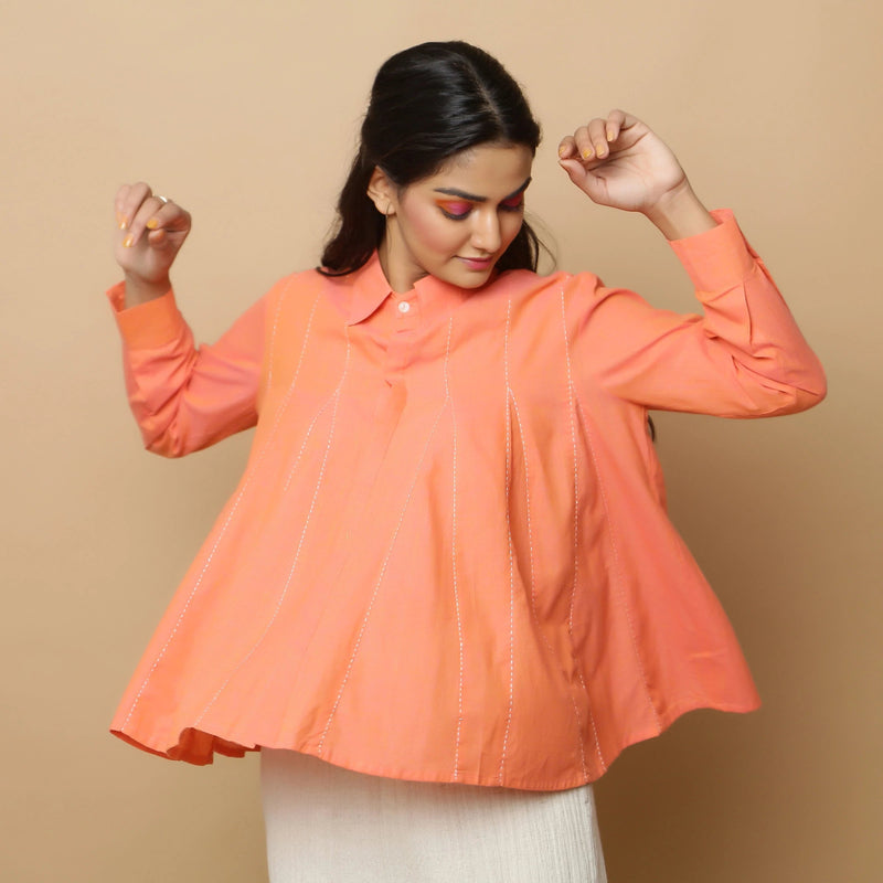 Front View of a Model wearing Salmon Pink Cotton Solid Godet Top