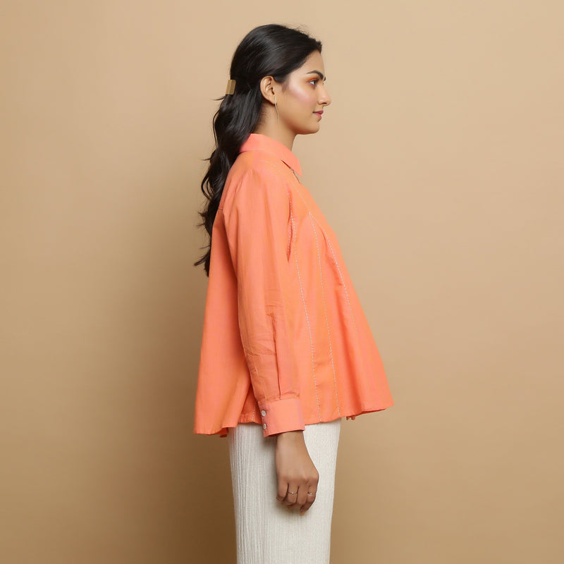 Right View of a Model wearing Salmon Pink Cotton Solid Godet Top