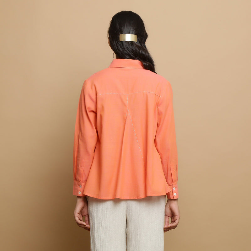 Back View of a Model wearing Salmon Pink Cotton Solid Godet Top