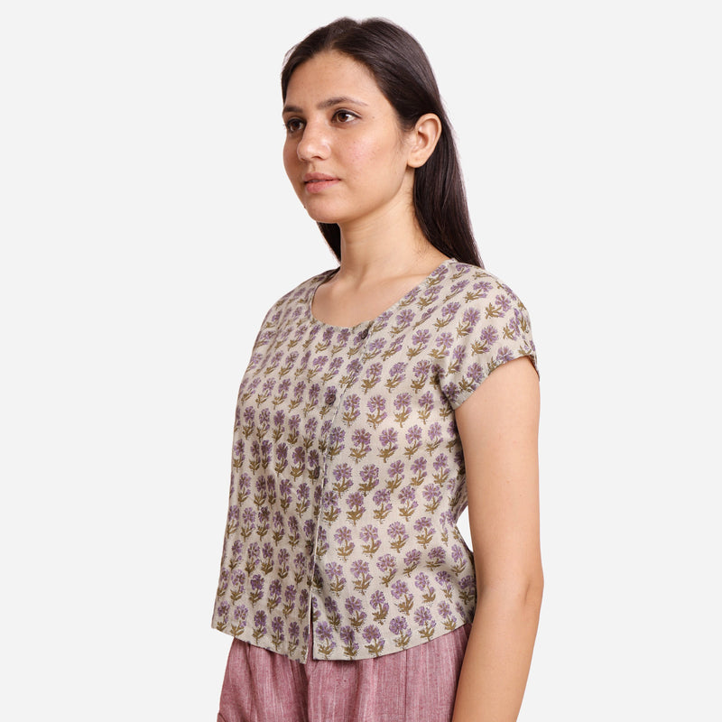 Left View of a Model wearing Sanganeri Print Short Asymmetric Blouse