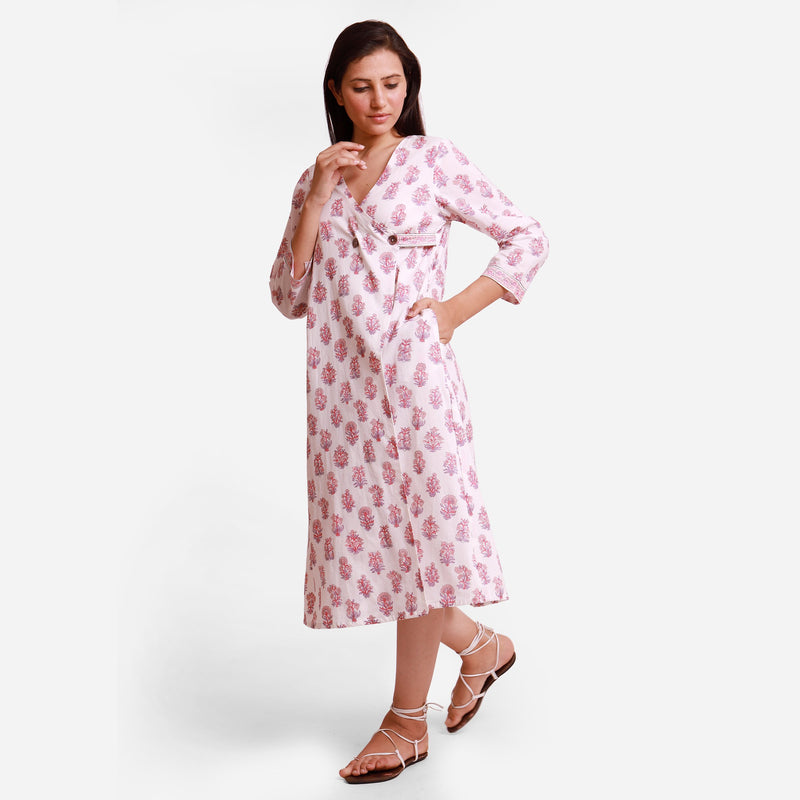 Left View of a Model wearing Floral Block Printed White Wrap Dress