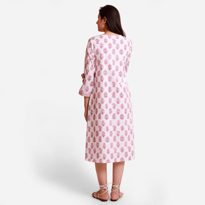 Back View of a Model wearing Floral Block Printed White Wrap Dress